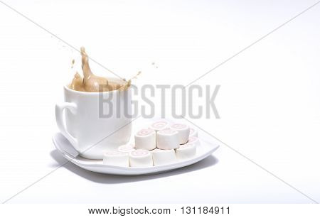 Cup Of Coffee on the plate and splash by marshmallow