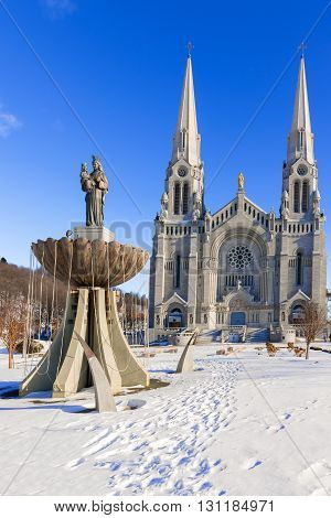 The Basilica of Sainte Anne de Beaupre is a basilica set along the Saint Lawrence River in Quebec Canada. It has been credited by the Catholic Church with many miracles of curing the sick and disabled. It is an important Catholic sanctuary which receives