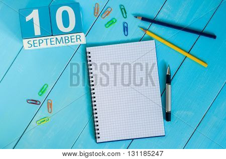 September 10th. Image of september 10 wooden color calendar on white background. Autumn day. Empty space for text. World First Aid Day.