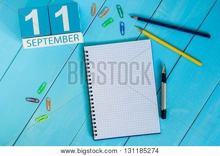 September 11th. Image of september 11 wooden color calendar on white background. Autumn day. Empty space for text.