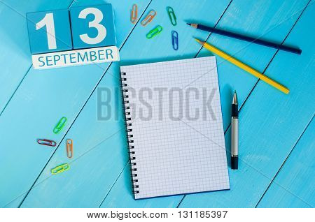 September 13th. Image of september 13 wooden color calendar on white background. Autumn day. Empty space for text.