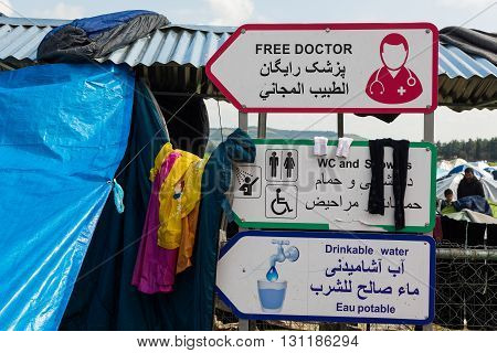 IDOMENI, GREECE - MARCH 17, 2015: Signs for water and medical services on March 17, 2015 in the refugee camp of Idomeni, Greece. For several weeks more than 10.000 refugees and immigrants wait here for the borders to open.