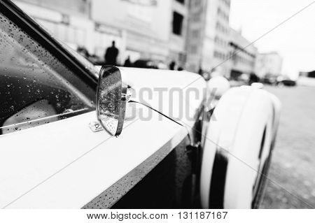 Side Rear-view Mirror At Old Vintage Retro Car. Black And White Photo
