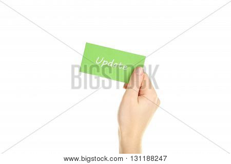 Hand holding card on a white background, update