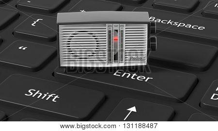 Antique radio transistor on black computer keyboard. 3D rendering