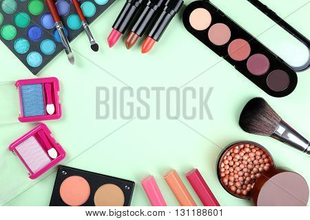 Makeup Brush And Cosmetics On A Mint Background