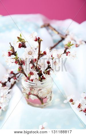 Tree Branches With Flowers In Glass Bottle