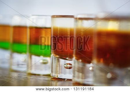 Drink shots in a row on the table in restaurant