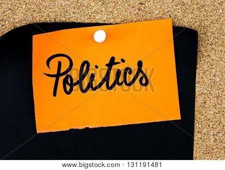 Politics Written On Orange Paper Note