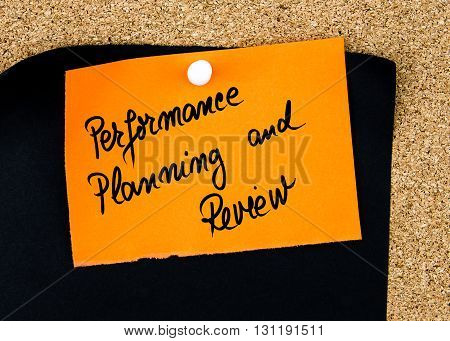 Performance Planning And Review Written On Orange Paper Note