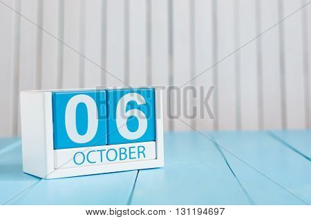 October 6th. Image of October 6 wooden color calendar on white background. Autumn day. Empty space for text.