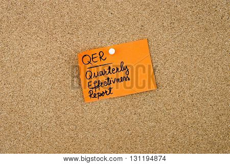 Qur As Quarterly Effectivness Report Written On Orange Paper Note