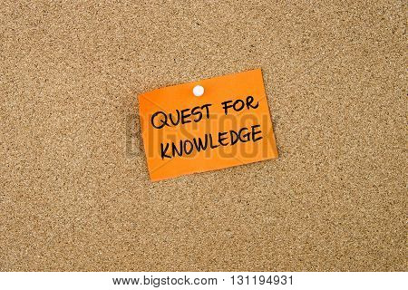 Quest For Knowledge Written On Orange Paper Note