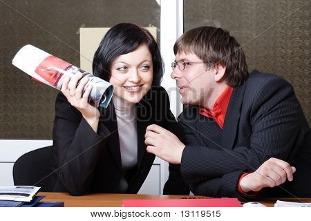 Group of 2 business people working together in the office.
