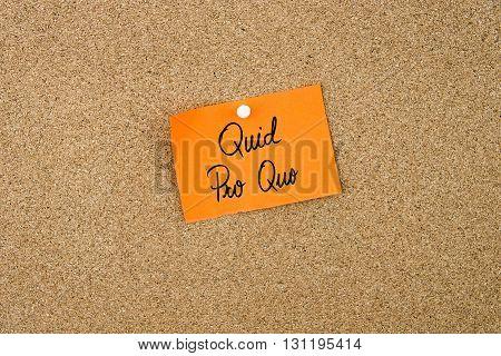 Quid Pro Quo Written On Orange Paper Note