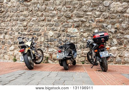 ISTANBUL TURKEY - JUL 26 2009: Three motorcycles parked on the base of Galata Tower in Istanbul Turkey