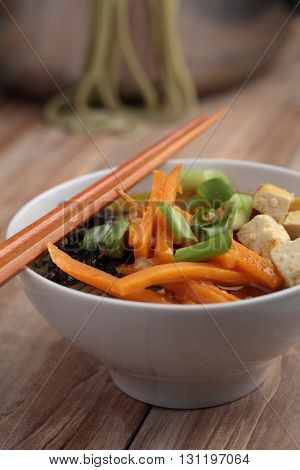 Green tea noodle soup with tofu and vegetables