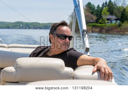 men 60 years old relaxing on a boat at summer