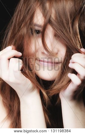 Young Woman Pulling Her Long Hair.