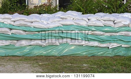 Wall of Sandbags and Tarp for Flood Protection