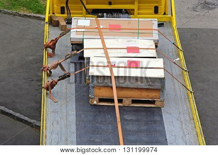 Cargo Pallets With Crates Shipping at Flatbed Truck