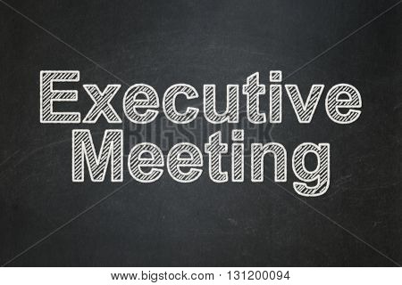 Business concept: text Executive Meeting on Black chalkboard background