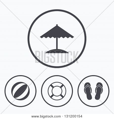 Beach holidays icons. Ball, umbrella and flip-flops sandals signs. Lifebuoy symbol. Icons in circles.