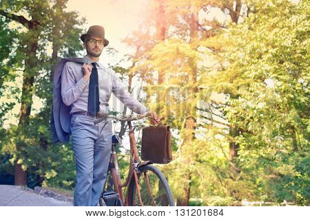 Businessman using his bike