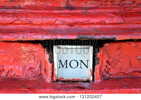 Red royal mail post box with MON label