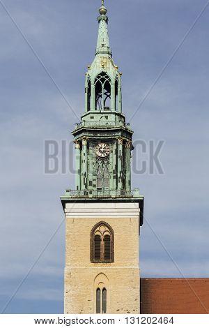 steeple of St. Marienkirche. Berlin Alexanderplatz in summer