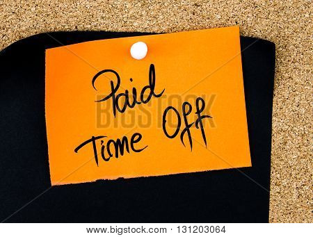 Paid Time Off Written On Orange Paper Note