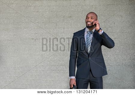 Business Man Talking On The Phone