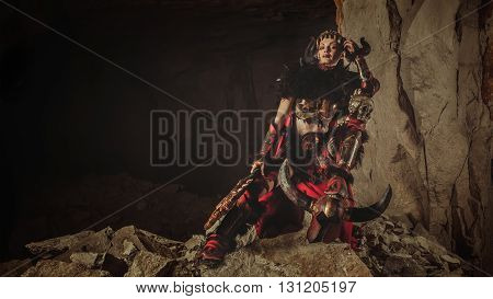 Beautiful Woman Warrior Dressed In Steel Armor Is Holding An Axe And Skull.