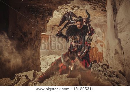 Beautiful Woman Warrior Dressed In Steel Armor Is Holding An Axe And Skull