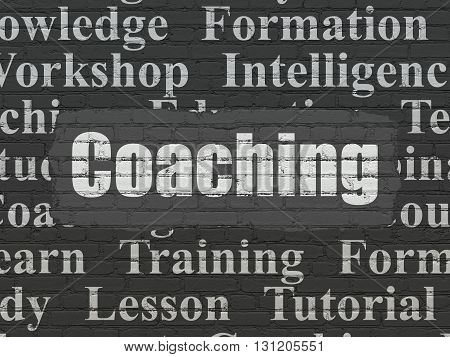 Studying concept: Painted white text Coaching on Black Brick wall background with  Tag Cloud
