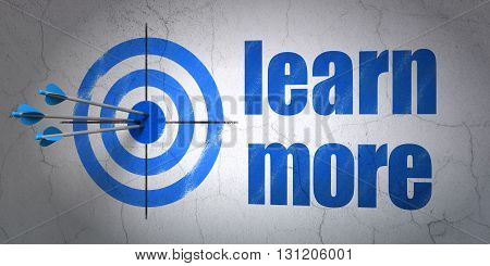 Success Learning concept: arrows hitting the center of target, Blue Learn More on wall background, 3D rendering