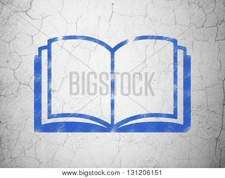 Learning concept: Blue Book on textured concrete wall background