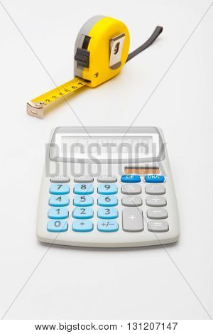 Instruments For Measurement And Calculating - Yellow Ruler And Calculator