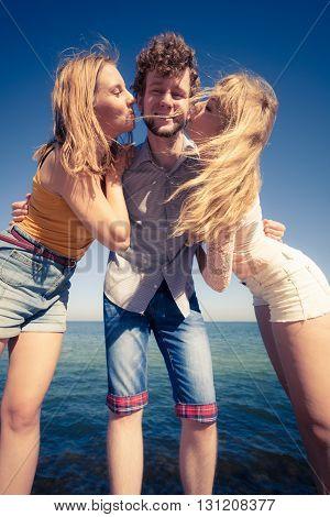 Two Girls Kissing One Boy Having Fun Outdoor