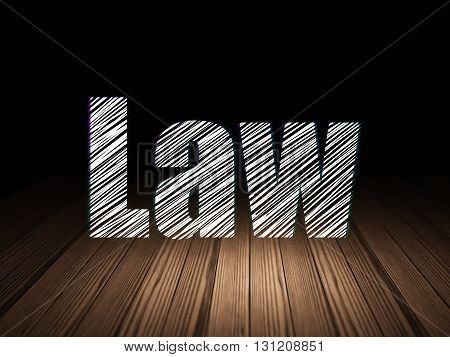 Law concept: Glowing text Law in grunge dark room with Wooden Floor, black background