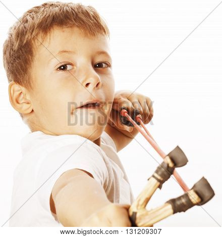 little cute angry real boy with slingshot isolated on white background close up