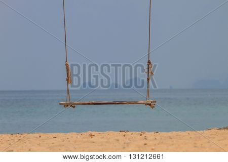 swing on beautiful tropical sea in summer beach island and the sea in Thailand