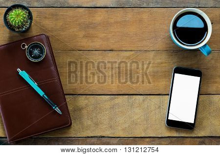 Office stuff with blank screen smartphone coffee cup pencil and leather notebook.Top view with copy space