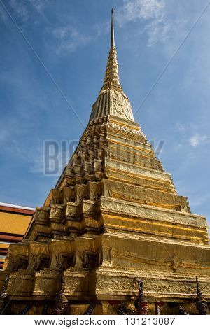 View of the Stupa inside the Grand Palace of Bangkok. Under the stupa, Statue Guardians are seen holding the stupa. The majestic and royal Thai art inside the palace is outstanding.