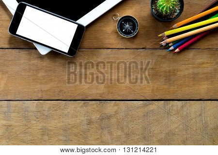Office workspace with blank screen tablet blank screen smartphone and color pencil .Top view with copy space