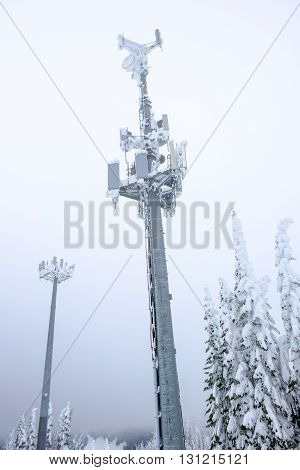 Snow covered telecommunication towers in the winter