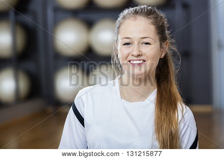 Confident Young Woman Smiling In Gym