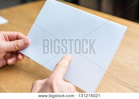 hand of businessman and blank white paper