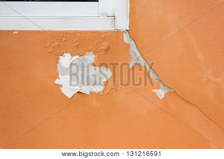 Deteriorated exterior paint of house wall, bad condition paint home wall