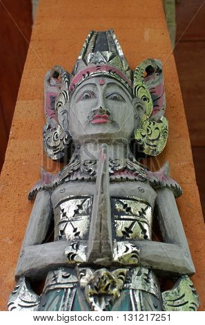 the balinese traditional style wooden welcome statue